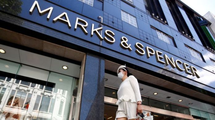 A woman walks past a Marks & Spencer store at Oxford Street, amid the outbreak of the coronavirus disease (COVID-19), in London, Britain, July 20, 2020