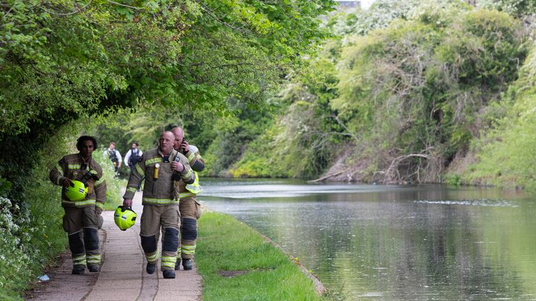Emergency services activity on the Grand Union Canal near Old Oak Lane. The body of a newborn baby has been found in the Grand Union Canal near Old Oak Lane in north west London, the Metropolitan Police said. Picture date: Sunday May 9, 2021.