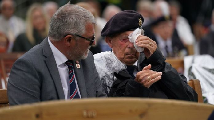 Veterans watch the official opening of the British Normandy Memorial in France