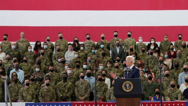 U.S. President Joe Biden delivers remarks to U.S. Air Force personnel and their families stationed at RAF Mildenhall, ahead of the G7 Summit, near Mildenhall, Britain June 9, 2021. REUTERS/Kevin Lamarque