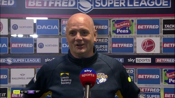 Leeds Rhinos coach Richard Agar said his side was 'clinging on' at the end, but did enough to claim victory over Warrington Wolves.