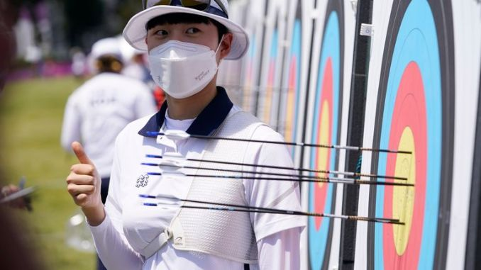 San An (KOR) poses near her target after scoring an Olympic record score of 680 in the archery ranking round during the Tokyo 2020 Olympic Summer Games. Pic: Jack Gruber-USA TODAY Network