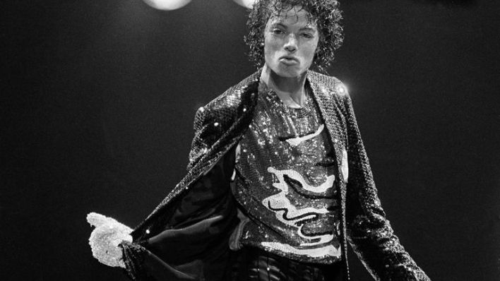The crystal glove became a part of Jackson's signature look - pictured in 1984 performing during the opening night of his Victory tour in LA. File pic