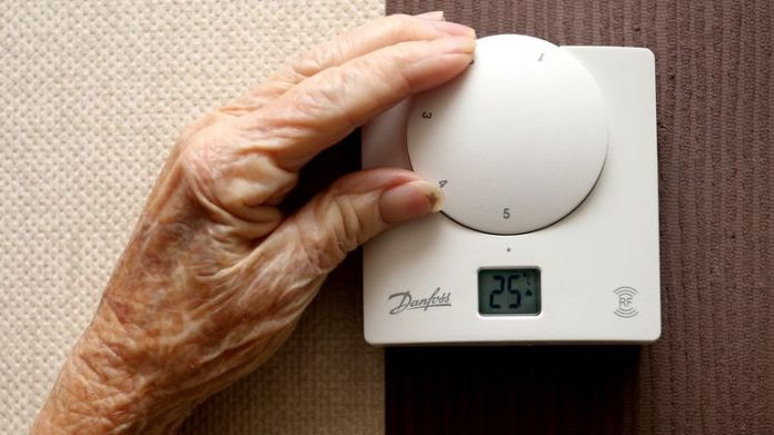 Jane Burney 94, from Childwall alters the thermostat in her home. The start of winter effects pensioners with concerns over heating bills PRESS ASSOCIATION Photo. Issue date: Wednesday November 19, 2014. See PA story . Photo credit should read: Peter Byrne/PA Wire