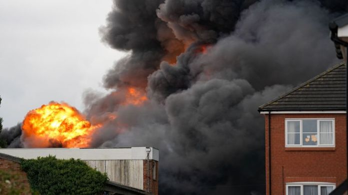 A huge plume of smoke can be seen rising above the scene of the incident on Juno Drive, Leamington Spa, with Warwickshire Fire and Rescue Service in attendance.
