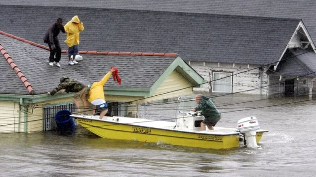 New Orleans residents rescued from their rooftop after Hurricane Katrina triggered devastating floods Pic: AP