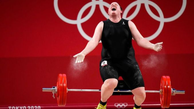 The 43-year-old reacts after dropping the barbell in a lift