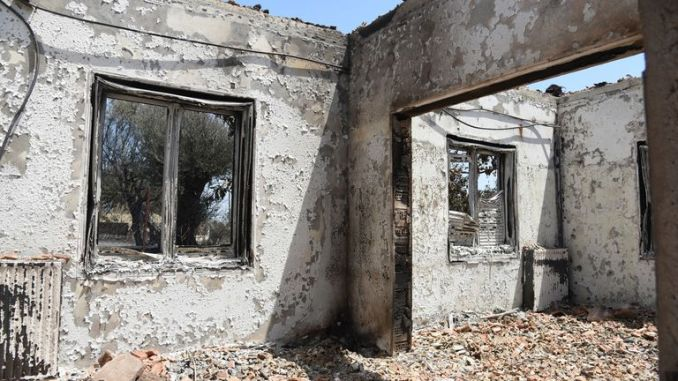 A burned house is seen in Ziria village, east of Patras, Greece, Sunday, Aug. 1, 2021. Pic: AP