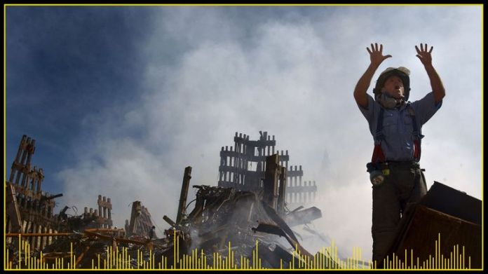 A fireman calls for more rescue workers to make their way to the rubble of the World Trade Center