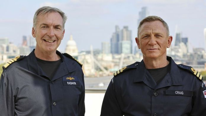 Ministry of Defence handout image of actor Daniel Craig (right), best known for playing the role of James Bond in the long-running 007 film series, wearing the honorary Royal Navy rank of Commander he has received from the Head of the Royal Navy, First Sea Lord Admiral Sir Tony Radakin (left), at the Corinthia Hotel.   Pic:LPhot Lee Blease/PA