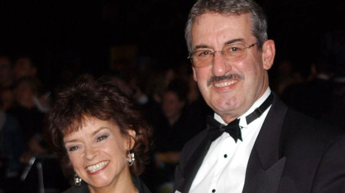 """File photo dated 15/10/2002 of actress Sue Holderness who played Marlene and actor John Challis who played Boycie in 'Only Fools and Horses' arriving at the National Television Awards at the Royal Albert Hall in London. Challis has died """"peacefully in his sleep, after a long battle with cancer"""", his family has said. Issue date: Sunday September 19, 2021."""