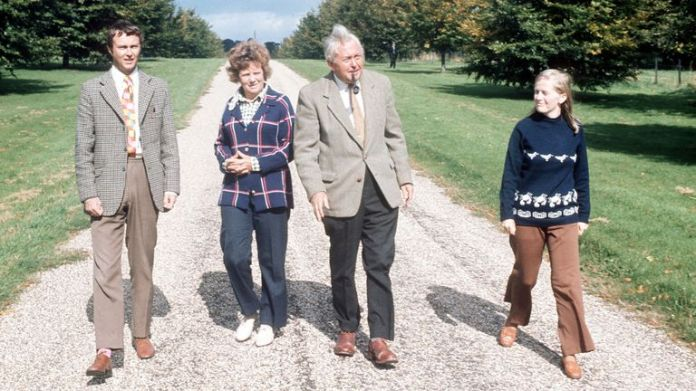 1974: The Prime Minister staying at Chequers on the eve of the start of his election campaign, strolls along a country lane with his son Robin, daughter-in-law Joy and wife Mary.