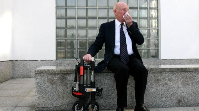 Sir Clive shows off his 'A-bike' invention outside the Design Museum in 2006