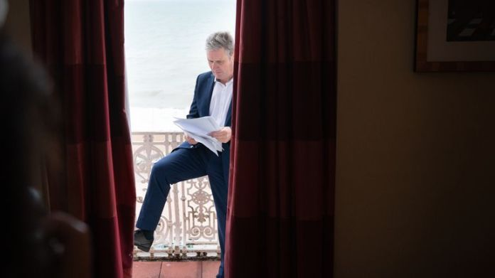 Labour leader, Sir Keir Starmer prepares his Labour Party conference speech in his hotel room in Brighton