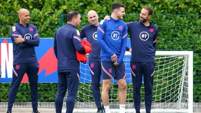 Southgate is pictured with Declan Rice at a training session in London on Saturday
