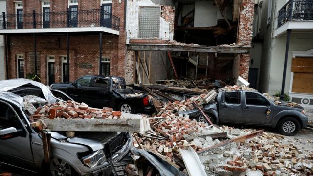 Destroyed cars are seen under debris from a collapsed facade after Hurricane Ida made landfall in Louisiana,  September 1, 2021