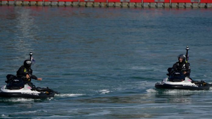 British Border Force officers on jet skis used to intercept small dingy with people thought to be migrants, train in Dover harbour England, Thursday, Sept. 16, 2021.  PIC:AP