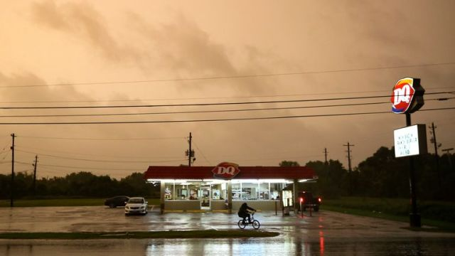 A Dairy Queen in Bay City stays open as customers try to get in a meal before it closes as Tropical Storm Nicholas approaches on Monday, Sept. 13, 2021.