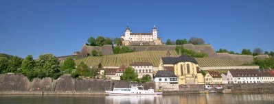 the castle above the river Main and the vine yards. The castle is a popular spot for a sundowner.