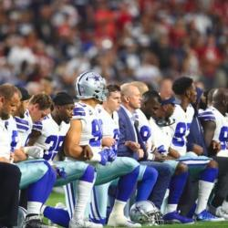 Dallas Cowboys lock arms and take a knee during the national anthem in protest of police brutality. Photo credit to Mark J. Rebilas-USA TODAY Sports