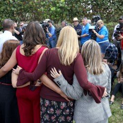 Broward County School Board members stand together as they talk with the media on Feb. 23, 2018 in Parkland, Fla. Teachers and school administrators returned to Marjory Stoneman Douglas High School for the first time after 17 victims were killed in a mass shooting at the school. (Mike Stocker/South Florida Sun Sentinel/TNS)