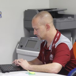 Hard at Work. Assistant Principal Daniel Most works in his office in student services. Photo by Nyan Clarke