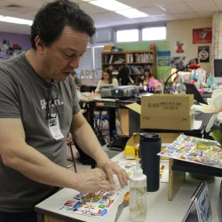 Michael Albert shows MSD art students how to collage. Photo by Fallon Trachtman