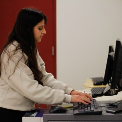Junior Einav Cohen demonstrates using the new print station in the cafeteria, which was installed on Oct. 10. The station is available for use every day. Photo illustration by Nyan Clarke