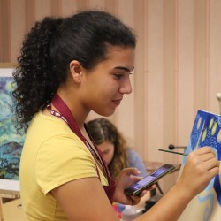 Senior Krystina Masihy works on a collaborative project between French club and Art on Tuesday Nov. 5. Photo by Kelly Cooke