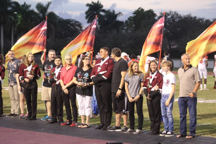 Band members stand with their families before the game. Photo by Travis Newbery