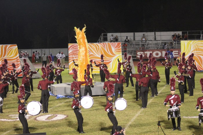 A demonstration of the fire prop during the Eagle Regiment's performance at Senior Night. Photo by Travis Newbery