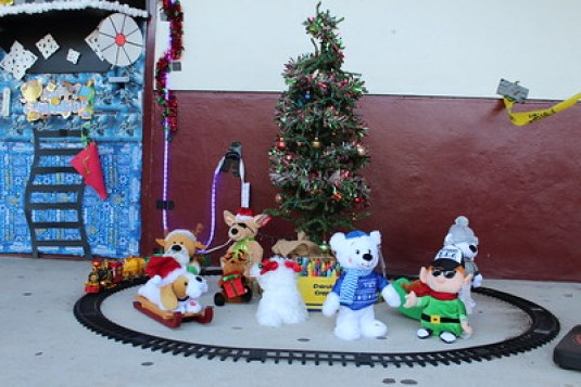 An elaborate design complete with a train track, mini tree, and stuffed animals, sits outside of Penny Pagano's door.