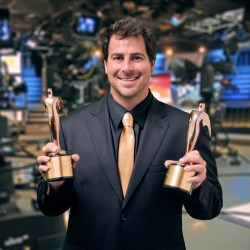"Evan Golden displays two of his awards on the set of  ""Eye on South Florida"" . Photo Courtesy of Jack Namer"