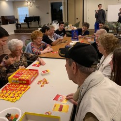 "DECA students and Aston Gardens residents participate in games for their chapter project ""Connecting the Generations."""