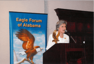 Eunie Smith at the Eagle Forum of Alabama Banquet in 2009 about to announce the winner of the Eagle Award.