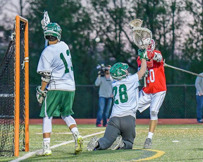 Baldwinsville attacker Ryan Gebhardt (20) gets one of his three goals past Fayetteville-Manlius goalie Ryan Boshart (28) and defender Tom Angelicola (13) in Wednesday's game. Gebhardt reached the 50-goal mark for the season, but the Bees took a 9-8 defeat to the Hornets.