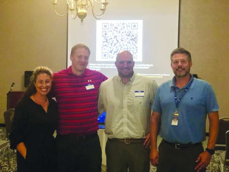 """On Aug. 19, the Business Teachers Association of New York State presented Cazenovia High School Business Teacher Christina New with the Department of the Year Award 2019-2020. Pictured: Last August, New, Todd MacIntosh, Tim Mascari and Patrick Ruddy (left to right) presented their vision for the district's """"Work-Based Learning"""" program to local business owners and operators at the Hampton Inn & Suites. (Kate Hill)"""