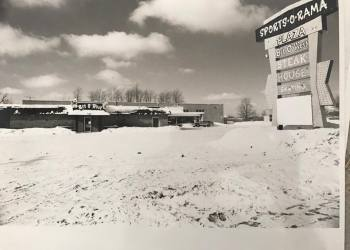 A black-and-white photograph of Sports-O-Rama Plaza, a roller rink in the 1960s.