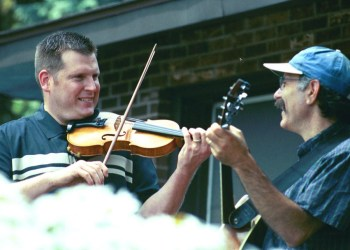 Reel Music, a trio featuring fiddlers Joe Davoli and Eileen Nicholson Kalfass and guitarist Harvey Nusbaum will perform authentic Irish tunes from 5 to 7 p.m. Friday, Sept. 17, at Johnson Park. The concert is part of Liverpool's first-ever Halfway to St. Patrick's Day event. Above are Davoli and Nusbaum.