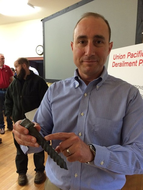 CHIEF ENGINEER Jason Rea of Union Pacific Railroad's western region, holds a lag screw like one of several that were sheared off on the track through Mosier, causing the June 3 train derailment.