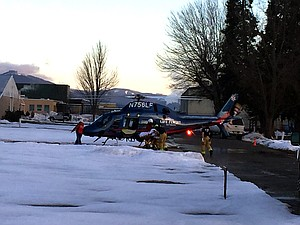 A life flight helicopter transports a patient from the Hood River County Fairgrounds to a hospital for medical care at about 7:08 a.m.