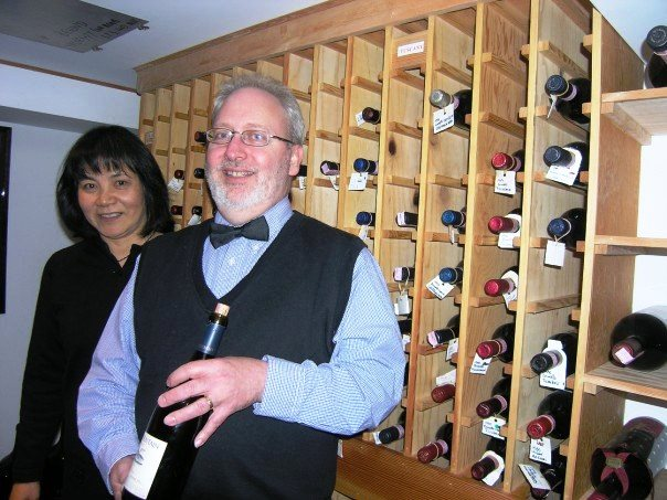 Keith and Yoshiko Robinson in a wine cellar