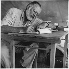 240px Ernest Hemingway Writing at Campsite in Kenya NARA 192655