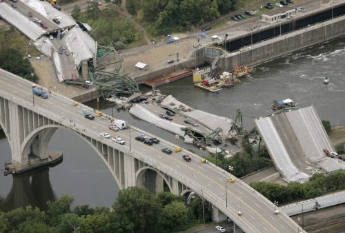The I-35W bridge collapse site as seen from a U.S. military helicopter in Minneapolis on August 4, 2007. Keeping U.S. roads and bridges safe requires federal funding, but lawmakers can't agree on how to pay for the Highway Trust Fund. Photo by REUTERS/Larry Downing