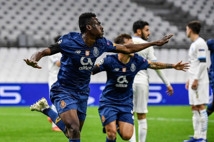 Zaidu Sanusi celebrates his goal for FC Porto in the UEFA Champions League match against Olympique de Marseille