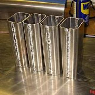 The runner halves, all TIG'd up, ready to be cut