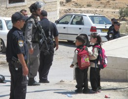 On the way home, these Hebron children run into the Israeli army. Photo EAPPI/M. Ward