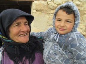 Masadi and one of her grandchildren. They are still able to smile, despite continued hardship. Photo EAPPI/K. Hodgson.