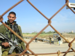 A soldier at Far'un agricultural gate in the Jayyus/Tulkarm area. Photo EAPPI/D. Montagut.