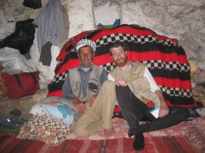 Hans and Abu Tariq watch TV together. Photo EAPPI/B. Thiel.